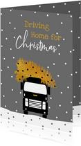 Driving Home For Christmas met kerstboom en truck