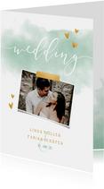 Einladung zur Hochzeit mit Foto und goldenen Herzen