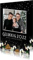 Feestelijke nieuwjaarskaart champagne, oliebollen en foto