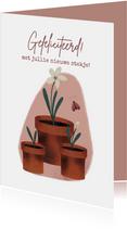 Felicitatiekaart met plantjes en bloem voor nieuwe woning
