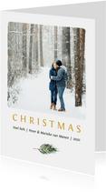 Foto kerstkaart met okergele tekst en groen takje