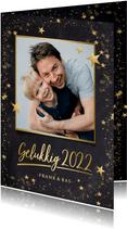 Foto nieuwjaarskaart zwart met gouden ster en 1 grote foto