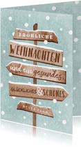 Geschäftliche Weihnachtskarte Schnee und Wegweiser