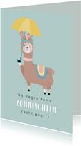 Kaart met getekende lama met een paraplu. In de kleur mint.
