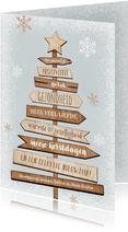 Kerstkaart kerstboom hout wegwijzers ster sneeuw winter