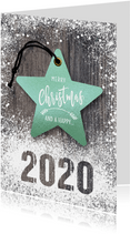 Kerstkaart kerstster op hout met sneeuw 2020