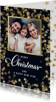 Kerstkaart met foto en sprankelende gouden sterren