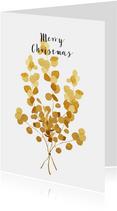 Kerstkaart met gouden eucalyptus