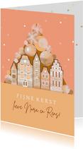Kerstkaart met kerstballen en schattige huisjes in het roze