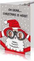 Kerstkaart met kerstman met verrekijker en foto's