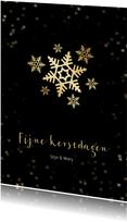 Kerstkaart zwart met sneeuwvlok van goud - een gouden kerst