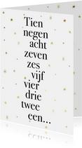 Leuke nieuwjaarskaart met typografie en gouden sterren