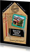 Leuke verhuiskaart van gevouwen pakpapier met eigen foto
