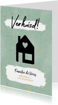 Moderne verhuiskaart met zwart huisje, spikkels & 'verhuisd'