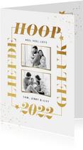 Nieuwjaarkaart typografie goud sterren spetters foto