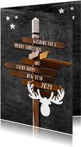 Nieuwjaarskaart Hippe houten wegwijzer op krijtbord