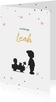 Silhouet geboortekaartje met een grote zus en baby in kar