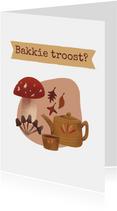 Sterkte kaartje met kop thee paddestoelen en herfstblaadjes
