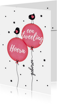 Tweeling meisjes vogeltjes op ballon