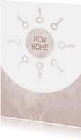 Umzugskarte 'new home' rosa mit Schlüsseln