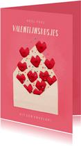 Valentijnskaartje valentijnskusjes uit een envelop