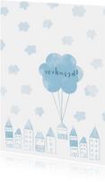 Verhuiskaart met huisjes en wolken