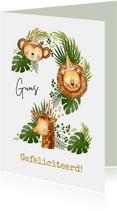 Verjaardagskaart met jungledieren en botanische bladeren