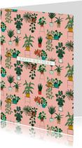 Verjaardagskaart met planten op een roze achtergrond.