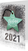 Zakelijke kerstkaart kerstster op hout met sneeuw 2021