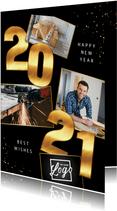 Zakelijke Nieuwjaarskaart 2021 goud cijfers spetters foto