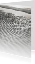 Zand en zee in de zon