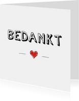 Bedankkaart met tekst bedankt en rood ingetekend hartje