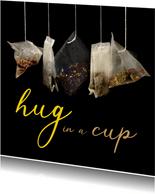 Beterschap hug in a cup met thee als cadeau