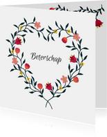 Beterschapskaart met bloemen in hartvorm