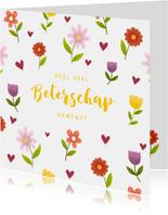 Beterschapskaart met vrolijke bloemen en hartjes