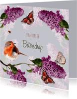 Beterschapskaart vogel tussen bloeiende Seringen
