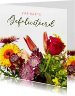 Bloemen verjaardagskaart met klassiek boeket en tekst