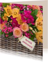 Bloemenmand rozen en lelies