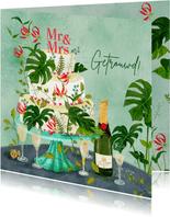 Botanisch versierde bruidstaart met champagne