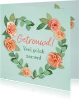 Felicitatiekaart met een hart van bloemen