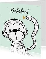 Felicitatiekaart met een vrolijke aap op mint achtergrond