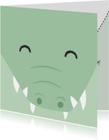 Felicitatiekaart met getekend gezicht van een krokodil.