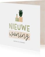 Felicitatiekaart nieuwe woning verhuisdoos en plantjes
