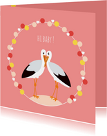 Felicitatiekaartje met lieve ooievaars in roze