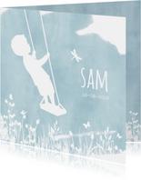 Geboortekaartje met een silhouet van een jongen op schommel