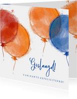Geslaagd! Felicitatie rood oranje blauwe ballonnen