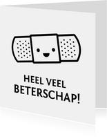 Grappige zwart witte beterschapskaart met vrolijke pleister