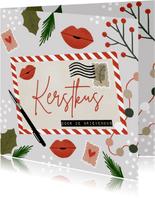 Hippe kerstkaart een kerstkus door de brievenbus