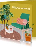 Hippe verhuiskaart met gezellige woonkamer