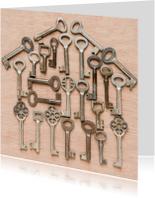 Huisje gemaakt van diverse sleutels